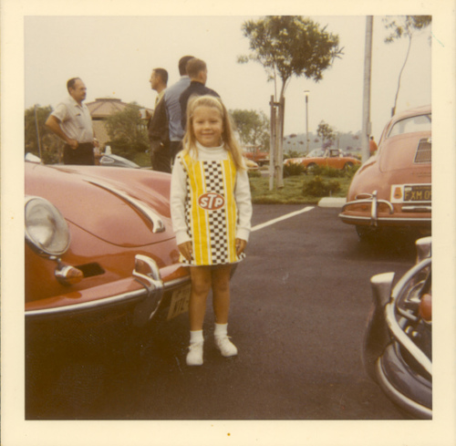 Glenda (at age 6) in her racing dress with her daddy's porsche